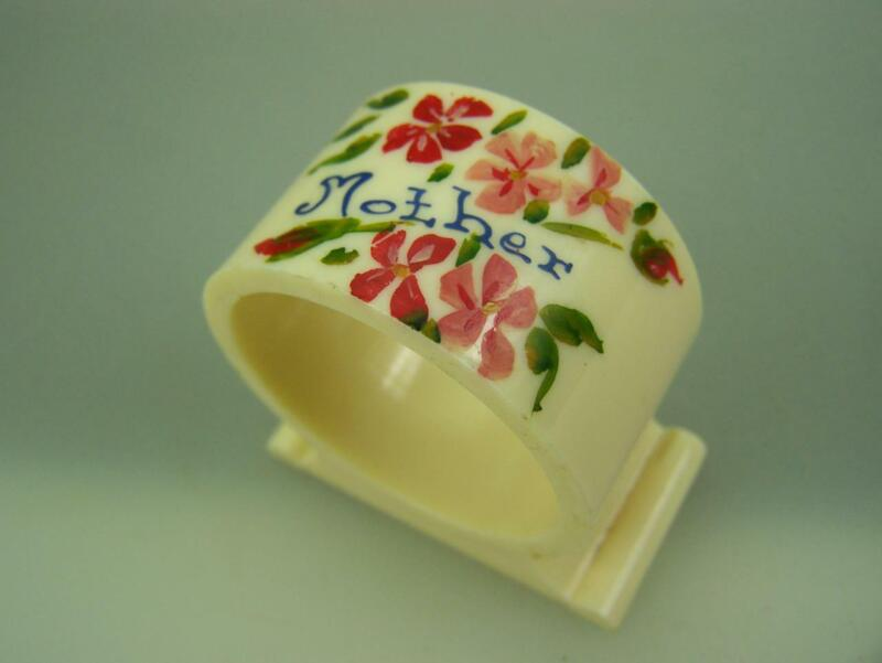 "Bakelite xylonite napking ring ""Mother"" with posies                         3024"