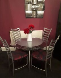 Ikea glass table and 4 chrome/silver chairs