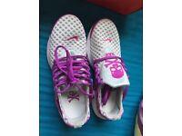 Purple and white Nike trainers