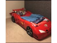 Stunning kids thermoplastic racing car bed with working headlights