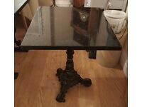 smaller cast iron and granite table
