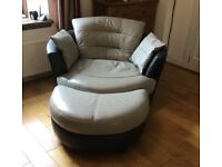 DFS large leather swivel chair with half moon footstool