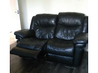 2 Seater Leather Sofa and One Leather chair both Black both Recline Good Condition
