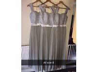 3 grey and silver bridesmaid dresses.