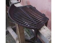 Cast iron fire grate/basket.