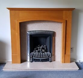 Oak fire surround with pink marble infill and hearth