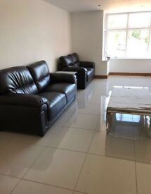 Brand new black leather sofas