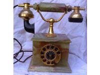 AN EARLY 20TH CENTURY STYLE,, 1970'S ORMOLU & ONYX TELEPHONE.