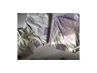 Two single cream and lilac duvets covers and pillowcases