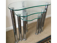 GLASS AND CHROME NEST OF THREE TABLES