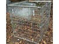 Heavy duty folding steel cage. Height 44 inches, width 48 inches, depth 40 inches