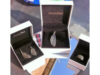 Pandora necklace, earings and ring.