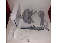 Nintendo Wii (leads + 2 games + HDMI Adapter)