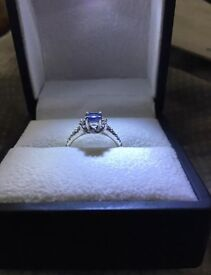 Tanzanite and diamond silver engagement ring