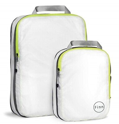 - FinnTM Compression Travel Packing Cube (2 piece set), White / Fluorescent Yellow
