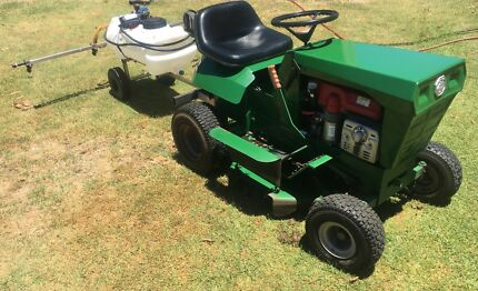 Cox ride on mower with spray trailer