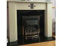 Black marble rear and hearth fireplace and surround