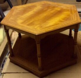Hexagonal coffee table with inlaid marquetry detail on top