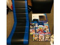 PS4 1TB (PlayStation 4 Sony) console, unopened games, 3 official controllers and Games Chair