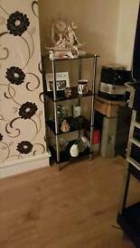 Black glass coffee table and shelf unit