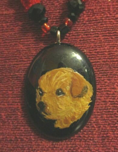 Norfolk Terrier hand-painted on black oval pendant/bead/necklace
