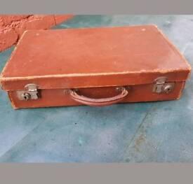 Vintage light brown leather suitcase