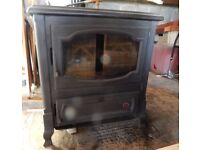 Efel Oil burning stove with Back Boiler. 66cm W, 67cm D, 72cm H.