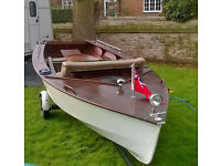 Fabulous wooden laser, converted to leisure motorboat, with engines, oars and trailer.