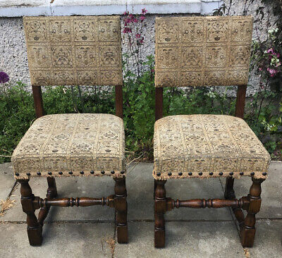 A Pair Of Carolean Style Oak Chairs With Tapestry Type Covers