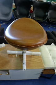 Brown Leather Upholstered Foot Stool in the style of Arne Jacobsen Egg Chair.