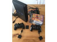 Ps2 console with official PlayStation controllers memory card and buzz games