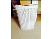White wicker laundry basket with lid
