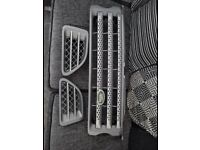 Original Land Rover Range Rover sport front and side grills to fit 2009 model.