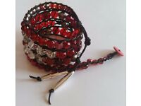 "New, handmade wrap bracelet with red, clear and silvertone beads on black cord. Fit 6"" or 7"" wrist"