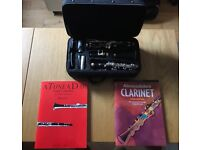 Clarinet (used once), case, two beginners books, spare reed, cleaning cloth.