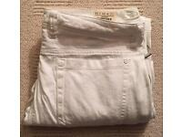 Brand new men's Diesel Threde Stretch white jeans with elasticated legs. W33 L34