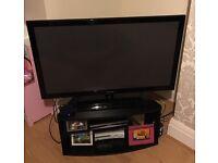 "Tv Stand and Black 50"" Samsung Plasma Tv"
