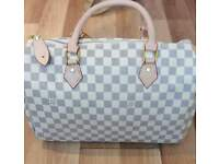 louis vuitton speedy ebene bags with lock and key