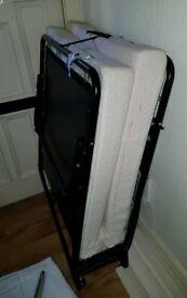 Single foldable metal bed guest with memory foam matteress on wheels