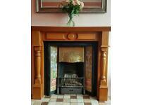 Tiled cast iron open fireplace