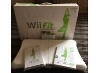 Wii Fit board with games.