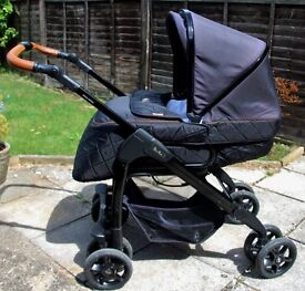 Birth to15kg (apprx 3) Pram to pushchair with cosy toes, rain cover. Black quilted/tan leather trim.