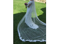 wedding dress and long princess veil