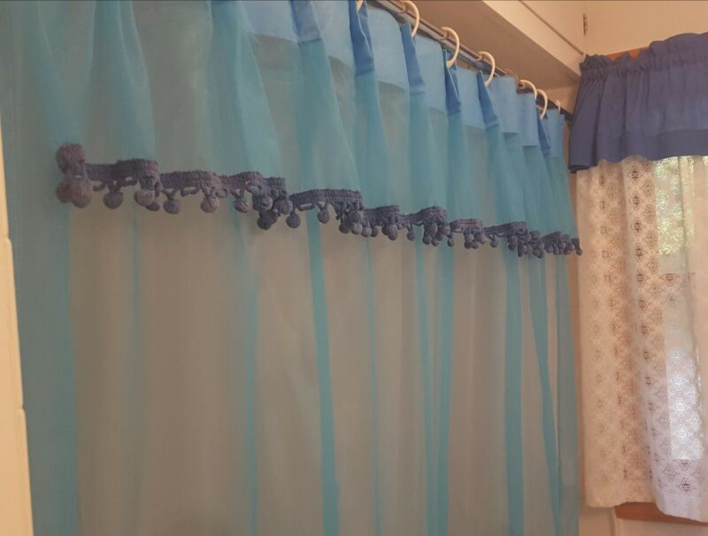 Vintage 1960s Sheer Blue shower curtain with pompoms