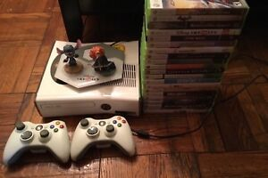 Xbox360 excellent with 2 wireless remotes and 21 games