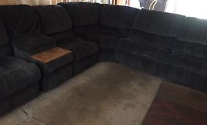 Sectional  with 2 recliners & hide a bid-sold