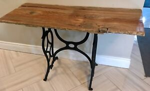 Unique aged wood table with cast iron footing