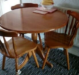 Solid wood dresser and matching round table and 4 chairs