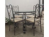 Glass and metal dining table chairs and matching drinks bar