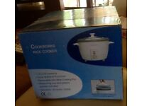 Cook works rice cooker 1.5 still boxed ,unwanted gift .